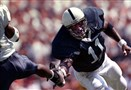 Penn State's LaVar Arrington lunges for the foot of Pitt wide receiver Julius Dixon during Penn State's 20-17 victory over Pitt at Beaver Stadium on Sept. 15, 1999.