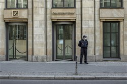 Standing guard outside a Deutsche Bank building in the center of Berlin on April 6, 2020.