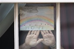 "A drawing of a rainbow with the word ""Hope"" is displayed on Thursday in one of the windows of 10 Downing Street, London, as Prime Minister Boris Johnson remains in the hospital following his admission on Sunday with continuing coronavirus symptoms."